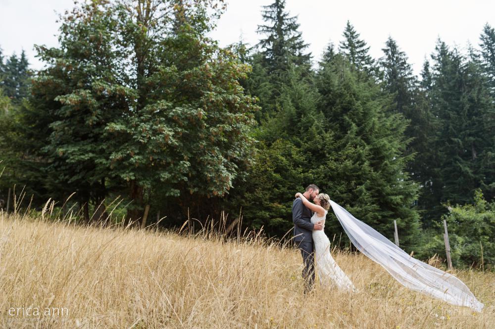 bride and groom hay field