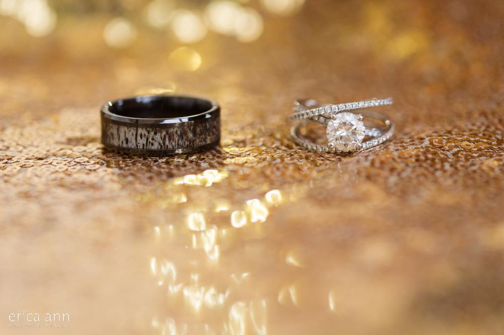 wedding rings on gold sequins